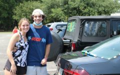Seniors Ty Schneider and Emma Mixon decorate their cars on the eve of their last first day.